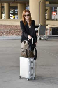 Julianne Moore with Rimowa Topas